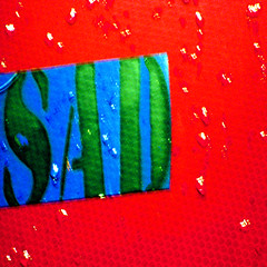 just the rain, he said (DREASAN) Tags: blue red blur green texture rain word typography sticker sad letters raindrops aufkleber stickon lackoffocus lof dreasanpics dreasanavb
