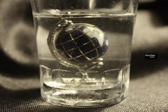 un mondo? (fiorellaq) Tags: macro glass swim canon acqua 450 bicchiere mondo sporco affogare annegare fiorellaq