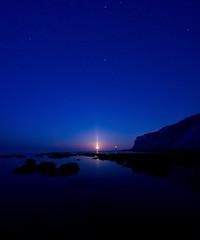 Moon pillar (Wilfried.B) Tags: longexposure nightphotography sea england seascape beach stars coast nightscape eastbourne eastsussex 1022mm moonset atmosphericoptics beachyheadlighthouse lightpillar moonpillar canon40d vertorama Astrometrydotnet:status=failed wilfriedb Astrometrydotnet:id=alpha20100478747895