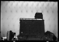 Dirty Film (Coffinradio) Tags: bw 120 rollei buildings box lumire lumiere sw 6x9 100 boxkamera rpx