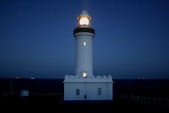 A Light To Guide You Home (photographerglen) Tags: ocean blue sea cliff lighthouse beach night