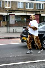 free tibet - running cat (stugee) Tags: london cat olympics freetibet catsuit catman eastlondon topcat stepneygreen