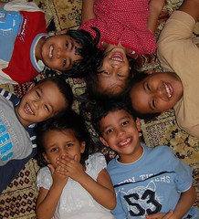Happy Circle (Shakir's Photography) Tags: family friends black cute smile kids tooth hair circle children fun carpet photography hope photo nice funny pretty floor image teeth joy happiness ground down laugh rug lay   shanko