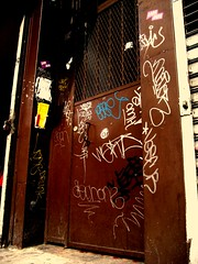 The Brown Door (Bodybuilding Liondancer) Tags: door newyorkcity brown streetart drunk graffiti sticker gate chinatown lowereastside tags east writers vandalism neckface jam ease werd seon vaf vaes dceve vescr