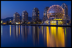 Blue hour falls over False Creek (Eric Flexyourhead) Tags: blue canada water yellow skyline architecture night vancouver reflections gold lights bc britishcolumbia dome falsecreek bluehour geodesic scienceworld telusphere telusworldofscience zd olympuse500 1445mm mywinners aplusphoto