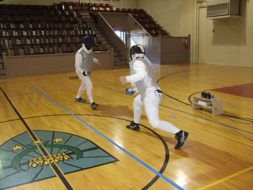 Caleb, right, at the Titan fencing event on Monday