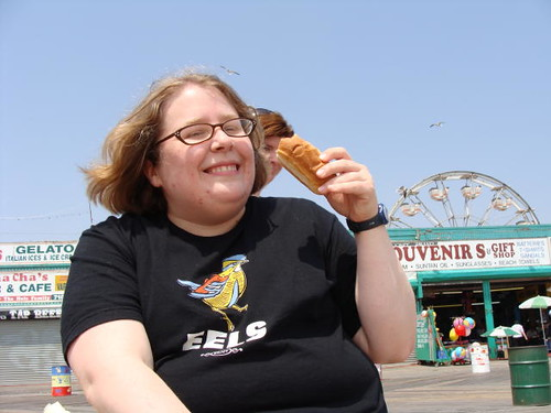 Eatin' a hot dog on the boardwalk.