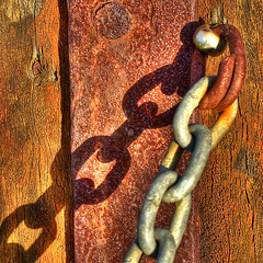b3697_3_1_2: Linking Rust and Wood (tengtan (catching up)) Tags: wood detail closeup wooden chains rust iron shadows post grain melbourne textures photofriday barrier links chiaroscuro 500x500 impressedbeauty auselite newacademy tengtan loveshackartisticeyecontest