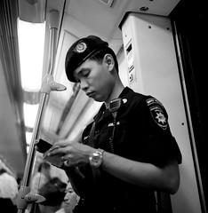 "Security Guard on subway - Bangkok (Sailing ""Footprints: Real to Reel"" (Ronn ashore)) Tags: street people blackandwhite portraits faces bangkok bnritratto bnvitadistrada kodaktrixasa400 rolleiflex35planar lastrolljuly200835mmsecurityguardonsubwayflickr"