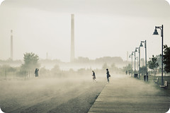 (uwajedi) Tags: woman lake toronto ontario canada beach lamp fog sepia bench haze sand day wind smokestack boardwalk lakeontario thebeaches fogography