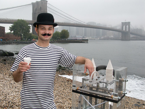 Landon holding his cup of East River. by Justin Parr