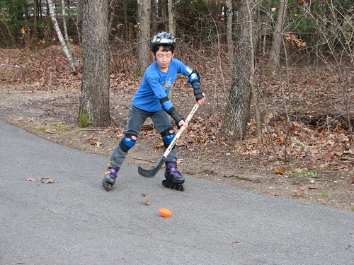 Adam plays street hockey