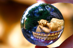 Seeing Buda in my crystal ball. (kees straver (will be back online soon friends)) Tags: gold searchthebest sphere refraction laos buda crystalball ultimateshot keesstraver