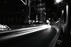 Night Traffic (dubbie) Tags: longexposure bw film hongkong traffic roads citigroup flyover admiralty lightstreams starbursts kodaktmax100 blackandwhitefilm canoneos1v cheungkongcenter