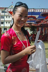Tibetan Woman wearing a red silk dress, white mala, khata, sunglasses,  with offerings, Tharlam Monastery Courtyard, Boudha, Kathmandu, Nepal (Wonderlane) Tags: nepal people woman sunglasses person turquoise buddhist daughter kathmandu mala humanbeing boudha offerings tibetanwoman wonderlane khata 9079 katag redsilkdress lamdre tharlammonasterycourtyard withofferings tibetanwomanwearingaredsilkdress whitemala