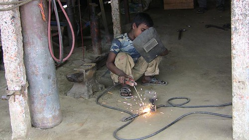 Child Labor - Welding in a Garage