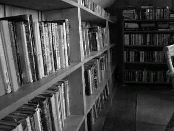 Old bookshelves in a library, from Wikipedia
