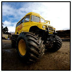 the School Bully (Robert Mynard) Tags: newzealand sky yellow clouds nikon mud fisheye cc creativecommons schoolbus monstertruck d300 robertmynard