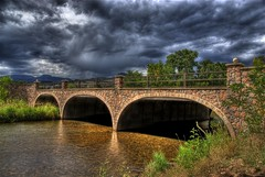 Arch Bridge, Lyons, Colorado (Thad Roan - Bridgepix) Tags: bridge trees water stone clouds colorado rocks arch overcast explore hdr lyons photomatix bouldercounty bridgepixing bridgepix stvraincreek mywinners 200808