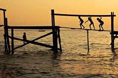 Silhouette of kids playing on a pier for boats above Lake Malawi at sunset - Cape Maclear - Malawi (PascalBo) Tags: africa boy sunset people silhouette yellow jaune outdoors kid nikon child d70 malawi enfant coucherdesoleil lakemalawi garçon afrique southernafrica eastafrica lakenyasa lakeniassa capemaclear 123faves lakenyassa afriqueaustrale afriquedelest lacmalawi pascalboegli lpbest2007 lacnyasa lacnyassa lacniassa