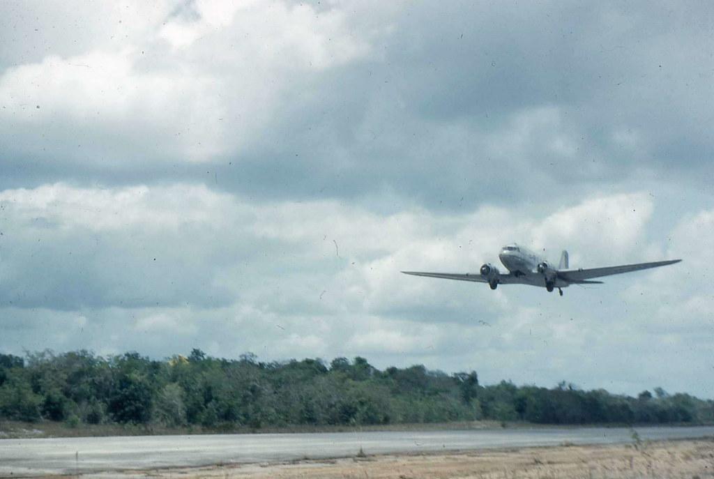Dakota over Mackenzie Airstrip, Mackenzie, Guyana