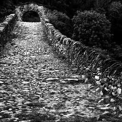 Anno Mundi (Lumase) Tags: bridge trees bw italy love topf25 stone square ancient path explore legend blacksabbath palabra pontedeldiavolo devilsbridge lanzo vallidilanzo explored mywinners lumase anawesomeshot luigimasella goldstaraward annomundi