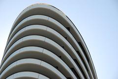 DSC_0716 (peregrinari) Tags: lines architecture curves wave melbourne bluesky docklands form sculptural 3008 melbournedocklands 20081004crayon melbourne3008