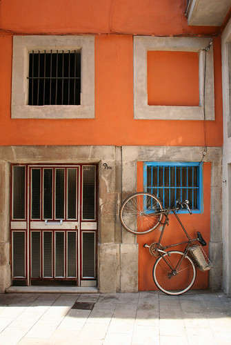 Bicycle in front of an orange house