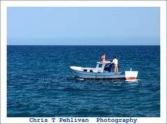 Turkish Fisherman and His Boat (CTPPIX.com) Tags: trip travel blue sea vacation mer canon turkey boat fishing fisherman mediterranean turkiye journey mersin med deniz mavi kayik akdeniz tekne turkei kizkalesi 40d icel ctpehlivan ctppix
