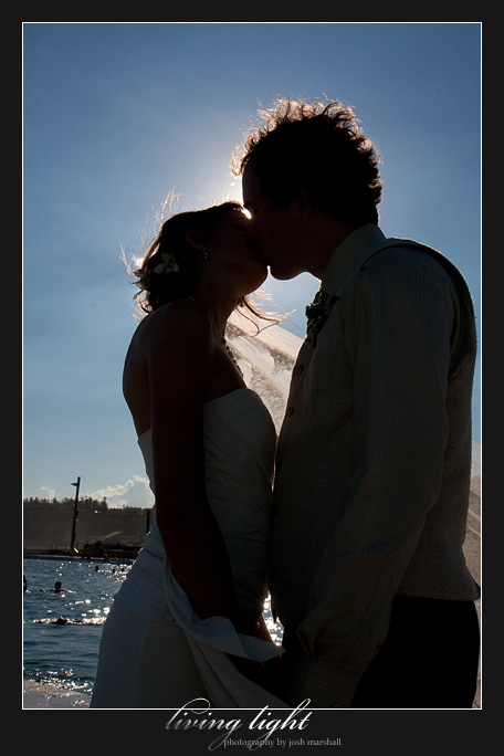 A silhouetted kiss with Newcastle Baths in the background.