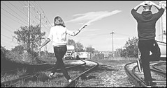 """Silly walk"" (Dimko F.) Tags: urban bw white black silly love look train pose him nikon hand you tracks her filter together rails bond d200 hold relation i"