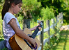 teach your children well (Laurarama) Tags: fence nikon child guitar diagonal odc nikkor105mmf25ai gettycollection d7000 gapjuly collectionp