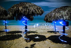 Playas (Ian David Blm) Tags: ocean longexposure wedding vacation lightpainting beach topv111 night clouds sand topv555 topv333 rocks waves topv1111 tide topv999 cuba shades fullmoon nighttime nightime mostinteresting topv777 caribbean playas conch parasols veradero lightwriting idb utata:project=nocturnal2