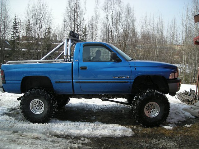 blue winter snow monster alaska bar truck giant season lights drive spring big lift suspension pickup super 1999 gas tires dodge roll ram 1500 ton monstertruck rollbar lifted bogger swamper