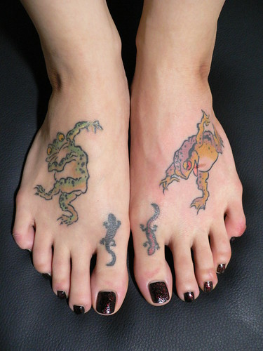 foot tattoos i love those geckos on your toes.. and very pretty pedicure too