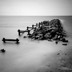Boatless (Ageel) Tags: longexposure trip travel sea summer sky bw white seascape black art tourism beach water d50 indonesia square lens asian photography nikon rocks asia squares fineart tripod cost sigma explore jakarta 1020mm ancol sq bnw squared sigma1020mm longexp  explored  ageel   bwsquare
