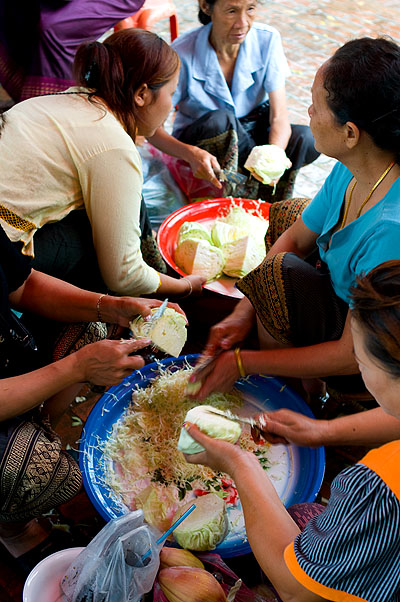 Woman preparing a funeral meal in Luang Prabang
