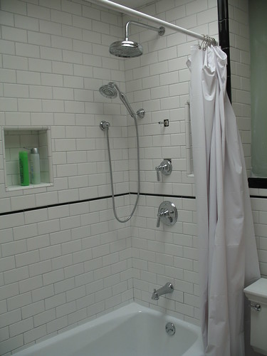 I Used Laticrete Silver Shadow With My AmericanOlean Designer White Subways  In The Bathroom. It Looks Fine.