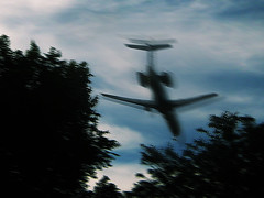 Turbulence (Madison Guy) Tags: trees clouds wind jet airliner turbulence andacertainamountofdigitalenhancementinshortphotoshop