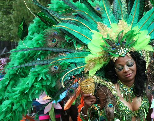 Woman dancer with big false eyelashes and green and peacock