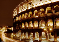 Colosseum on Halloween Night (Raphael Borja) Tags: longexposure italy rome roma building lamp sepia architecture night canon golden lowlight ancient ruins italia traffic roman arches landmark monotone colosseum arena empire coliseum gladiator colosseo flavianamphitheatre ef1740mmf4l 40d