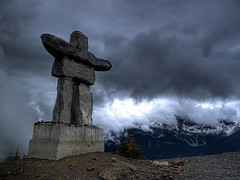 Head in the Clouds (ecstaticist - evanleeson.com) Tags: travel light sculpture food cloud mountain holiday canada ski bike sport statue rock stone vancouver canon whistler three exposure break angle symbol hiking altitude sightseeing wide culture peak columbia aerial alpine biking granite scree inuit gondola british olympics inukshuk hdr rubble blackcomb indigenous 2010 peaktopeak photomatix tonemapped tonemapping g10 sliing