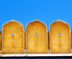 Tiny blue windows (Vani Kurup) Tags: blue sky india abstract window yellow wall hope perception view fort mind gateway fortification defense restricted jaipur rajasthan amberfort parapet rampart amerfort safeguard lookingbeyond viewonlife restrictedview nouvellephotography lifeasweseeit windowsofthemind
