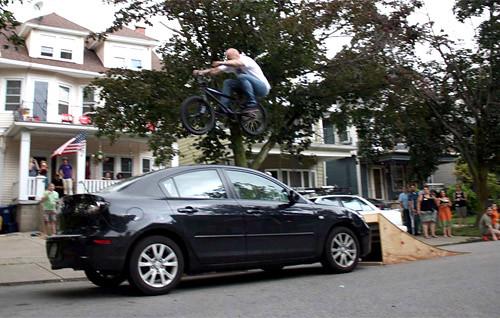 Jim Cielencki - Jumping over his car.