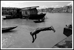 Uncontrollable Naughtiness (Tipu Kibria~~BUSY~~) Tags: boy water childhood swim canon river scott eos photo kid jump jumping child walk worldwide dhaka bangladesh sadarghat naughtiness xti canon1785mmisusm 400d kelbys