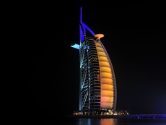 Burj al Arab (BlueSkyinBY) Tags: city longexposure building night skyscraper hotel nikon dubai uae illumination emirates arab burjalarab jumeirahbeach d300 tomwright 7stars