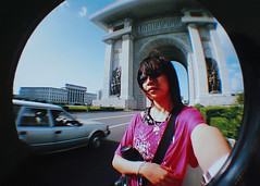 Fisheye souvenir photo. (ShanLuPhoto) Tags: selfportrait idea day propaganda flag north games korea communism kimjongil national leader mass dear archoftriumph socialism selfprotrait pyongyang dprk  juche kimilsung   looloo