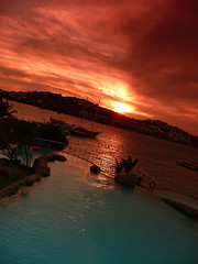 Yalikavak Sunset (Defining  Beauty) Tags: blue sunset sea sun holiday colour tree beach water pool beautiful beauty rock clouds turkey hotel boat view spectrum turkiye calm fresh palm stunning relaxation flipper bodrum defining yalikavak heatwaves definingbeauty