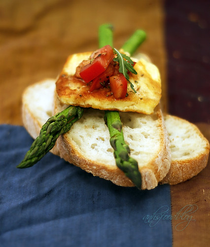 Asparagus, fried haloumi and tomato salsa on cibatta slice
