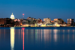 Madison at Dusk (Todd Klassy) Tags: city travel blue windows light vacation sky urban panorama sunlight lake color colour reflection art tourism water beautiful beauty horizontal skyline wisconsin architecture night buildings landscape outdoors lights evening coast office still colorful downtown cityscape view state dusk horizon fineart capital nobody center visit scene row panoramic clear capitol madison shore dome convention coastline recreation bluehour copyspace hue statestreet wi planner lastlight stockphoto lakemendota mononaterrace stockphotography destinations lakemonona isthmus olinpark danecounty wisconsinphotographers toddklassy madisonwisconsinskyline communityandconventioncenter